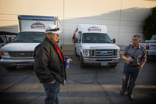 Will Dellaechaie, left, president of Summit Restoration and co-owner/managing member of Everest Construction, and Ken Bagwell, general manager of Everest Construction, talk on Friday, March 25, 20 ...