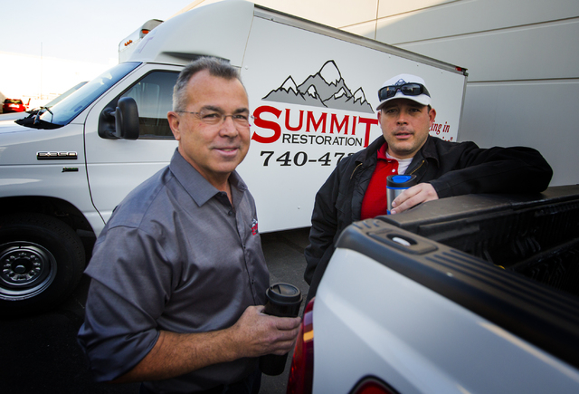 Ken Bagwell, left, general manager of Everest Construction and Will Dellaechaie, president of Summit Restoration and co-owner/managing member of Everest Construction, stand for a photo on Friday,  ...