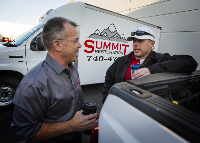 Ken Bagwell, left, general manager of Everest Construction and Will Dellaechaie, president of Summit Restoration and co-owner/managing member of Everest Construction, talk on Friday, March 25, 201 ...