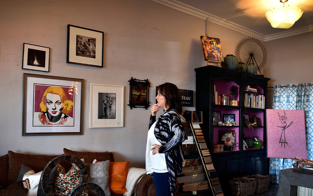 Interior designer Jill Abelman ponders an artist's work in her showroom at her Inside Style offices in downtown Las Vegas Friday, March 25, 2016. David Becker/Las Vegas Review-Journal Follow @davi ...