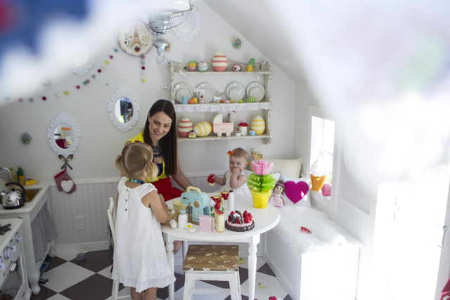 Interior designer Jannicke Ramso, owner of Tiny Little Pads, plays with daughters Nahla, 3, and Miliah, 11 months, inside a playhouse she designed and her husband helped build at their home on Tue ...