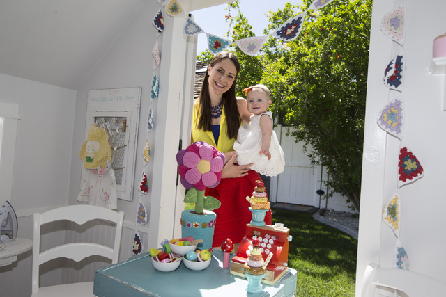 Interior designer Jannicke Ramso, owner of Tiny Little Pads, poses with her 11-month-old daughter Miliah at their home on Tuesday, April 12, 2016, in Las Vegas, Erik Verduzco/Las Vegas Review-Jour ...