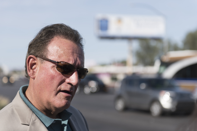 Tony Romo, vice president of business development with the Las Vegas Medical Marijuana Association, speaks with a reporter during a walking tour of various medical marijuana dispensaries in Las Ve ...