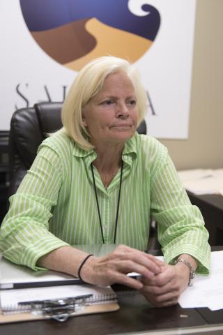 "Brenda Gunsallus, co-owner of Sahara Wellness, speaks with a reporter at the dispensary during a walking tour of various medical marijuana dispensaries in Las Vegas' ""Green District"" Wednesday, Ap ..."