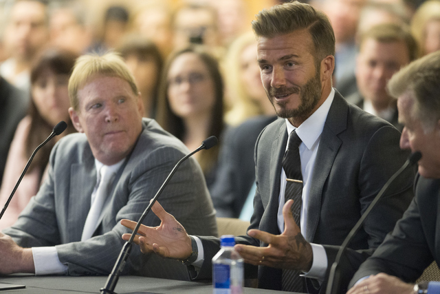 Former soccer star David Beckham, right, with Oakland Raiders owner Mark Davis, speaks on a proposed Las Vegas domed stadium during a meeting with local government and UNLV officials at the Stan F ...