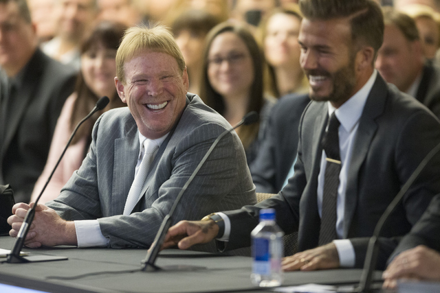 Oakland Raiders owner Mark Davis, left, and former soccer star David Beckham, share a laugh while speaking on a proposed Las Vegas dome stadium during a meeting with local government and UNLV offi ...