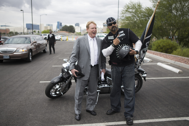 Oakland Raiders owner Mark Davis, left, poses with fan Eric Carrillo following press conference on the proposed Las Vegas dome stadium at the Stan Fulton Building at UNLV on Thursday, April 28, 20 ...