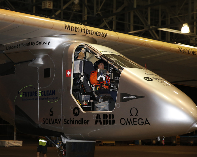 Solar Impulse 2 pilot Bertrand Piccard prepares to fly across the Pacific in a solar plane from Kalaeloa Airport, Thursday, April 21, 2016, in Kapolei, Hawaii.  (Marco Garcia/The Associated Press)