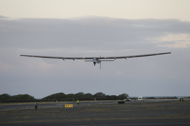 The Solar Impulse 2 solar plane lifts off at the Kalaeloa Airport, in Kapolei, Hawaii.  (Marco Garcia/The Associated Press)