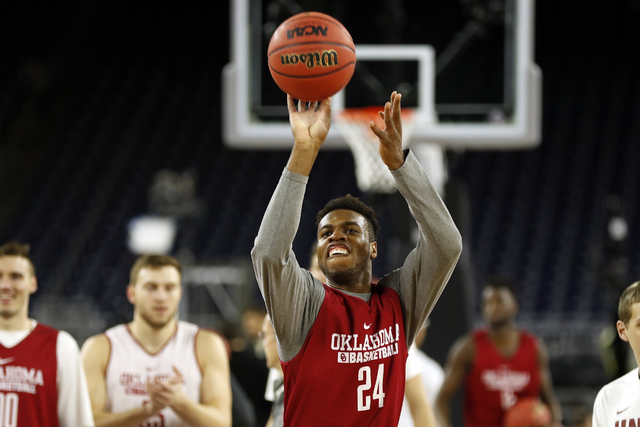 Oklahoma's Buddy Hield shoots during a practice session for the NCAA Final Four college basketball tournament Friday, April 1, 2016, in Houston. (AP Photo/David J. Phillip)