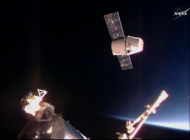The SpaceX Dragon cargo ship approaches the International Space Station, Sunday April 10, 2016. (NASA TV via AP)