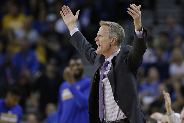 Golden State Warriors coach Steve Kerr argues a call during the second half of the team's NBA basketball game against the San Antonio Spurs on Thursday, April 7, 2016, in Oakland, Calif. Golden St ...