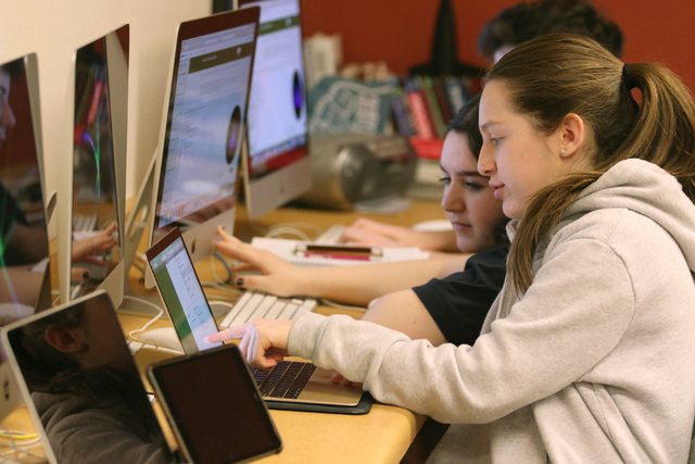 Ari Goodman, 14, right, assists Nicole Derei, 14, center, in Introduction to Computer Programming class at The Adelson Educational Campus Tuesday, March 15, 2016, in Las Vegas. The school expects  ...
