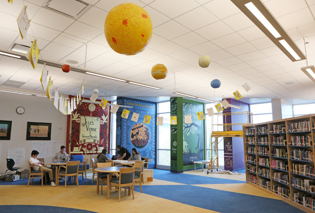 Students work in the library/media center at The Adelson Educational Campus Tuesday, March 15, 2016, in Las Vegas. The school expects to retrofit the space for a new technology and learning incuba ...