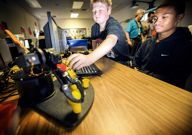 Silvestri Junior High School students Jesse Coopedge, left, and Trajon Saap conducts a robotics demonstration on Tuesday, March 29, 2016. The school recently received a $14.1 million grant to purc ...