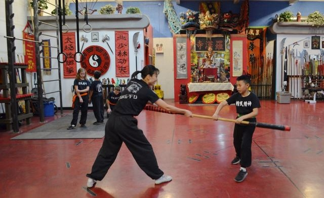 Yuko Brazil works with Ethan Young, 11, at the Lohan School of Shaolin, 3850 Schiff Drive. Ginger Meurer/Special to View