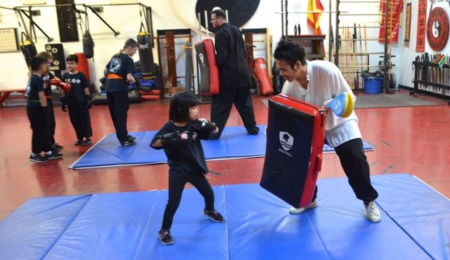 Alicia Young, 5, works with Alex Baginski in a children's class at the Lohan School of Shaolin, 3850 Schiff Drive. Ginger Meurer/Special to View