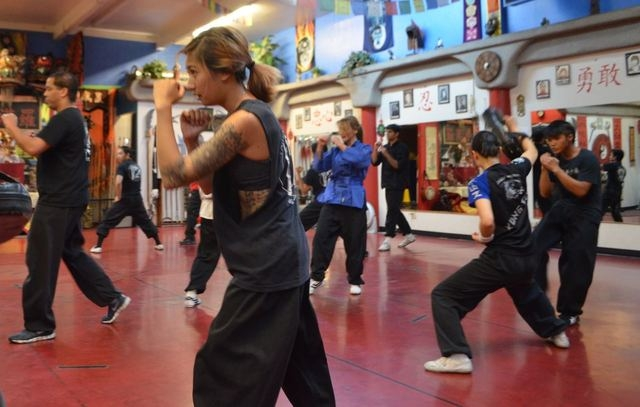 Teen and adult students practice Kung Fu at the Lohan School of Shaolin, 3850 Schiff Drive. Ginger Meurer/Special to View
