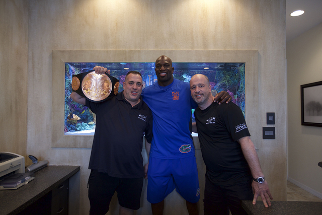 Wayde and Brett with Titus O'Neil in front of his new Florida Gator themed tank. (Courtesy Animal Planet)