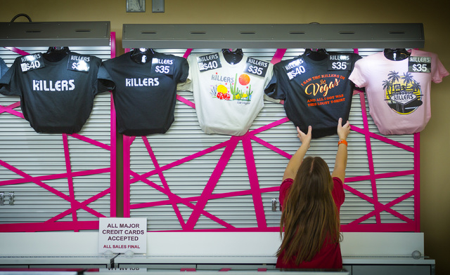 A woman places The Killers t-shirts in a booth at T-Mobile Arena on Wednesday, April 6, 2016. Jeff Scheid/Las Vegas Review-Journal Follow @jlscheid