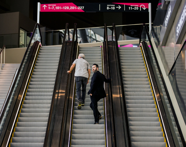 Men ride an escalator at T-Mobile Arena on Wednesday, April 6, 2016. Jeff Scheid/Las Vegas Review-Journal Follow @jlscheid