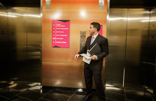 Public relations specialist Robert Flicker waits for an elevator at T-Mobile Arena on Wednesday, April 6, 2016.  Jeff Scheid/Las Vegas Review-Journal Follow @jlscheid