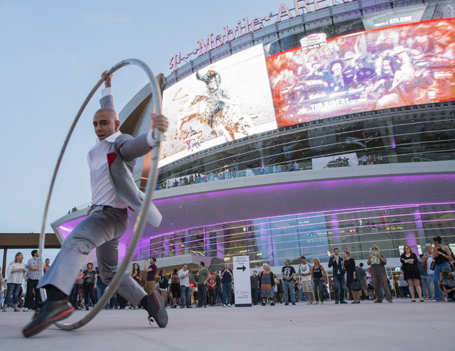 Jonas Woolverton performs on the cyr wheel outside T-Mobile Arena during opening night of the new Las Vegas entertainment venue on Wednesday, April 6, 2016. Highlights included performances by The ...