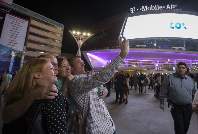 Jaime Henneman, from left, Dave Dirken and Mike and Shannon Reiter pose for a photo outside T-Mobile Arena during opening night of the new Las Vegas entertainment venue, Wednesday, April 6, 2016.  ...