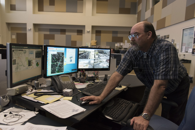 David Crisler, traffic operations supervisor with Freeway and Arterial System of Transportation traffic center, monitors traffic flow from the center during T-Mobile Arena's opening day in Las Veg ...