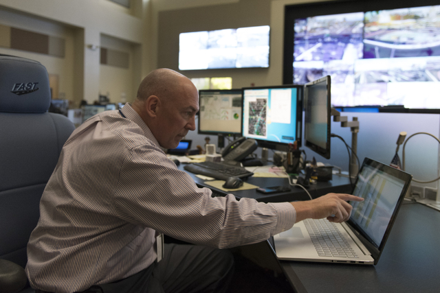 Brian Hoeft, director with Freeway and Arterial System of Transportation traffic center, monitors traffic flow from the center during T-Mobile Arena's opening day in Las Vegas Wednesday, April 6,  ...