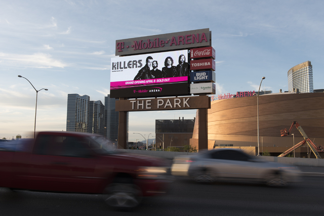 Traffic passes T-Mobile Arena's marquee on Tropicana Avenue during T-Mobile Arena's opening day in Las Vegas Wednesday, April 6, 2016. The 20,000 seat arena's opening event featured a concert by T ...