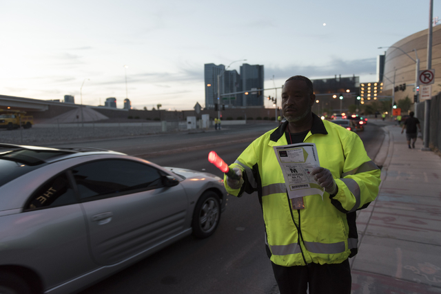 Donald Sanders of Las Vegas Traffic Control directs traffic to arena parking from Frank Sinatra Drive during T-Mobile Arena's opening day in Las Vegas Wednesday, April 6, 2016. The 20,000 seat are ...