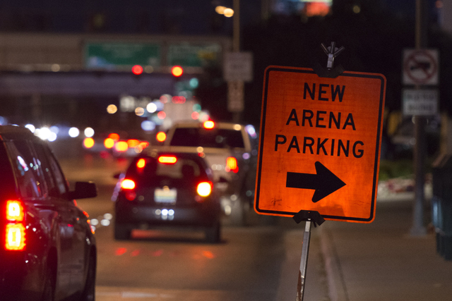 Signage for arena parking sits in from of Excalibur hotel-casino on Tropicana Avenue during T-Mobile Arena's opening day in Las Vegas Wednesday, April 6, 2016. The 20,000 seat arena's opening even ...