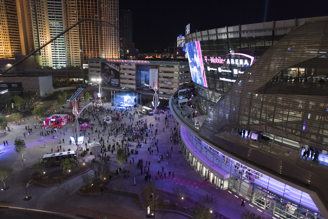 Pedestrians arrive at T-Mobile Arena during the arena's opening day in Las Vegas Wednesday, April 6, 2016. The 20,000 seat arena's opening event featured a concert by The Killers, Wayne Newton and ...