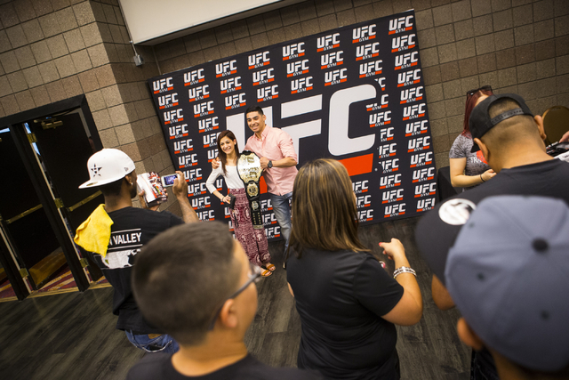 People hang out in the concourse area as UFC 197 gets started at the MGM Grand Garden Arena in Las Vegas on Saturday, April 23, 2016. (Chase Stevens/Las Vegas Review-Journal) Follow @csstevensphoto