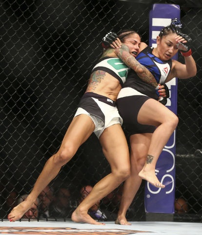 Juliana Lima, left, looks to take down Carla Esparza during a womenճ strawweight bout in UFC 197 at the MGM Grand Garden Arena in Las Vegas on Saturday, April 23, 2016. Chase Stevens/Las Veg ...