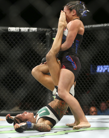 Juliana Lima, left, gets a kick in against Carla Esparza during a womenճ strawweight bout in UFC 197 at the MGM Grand Garden Arena in Las Vegas on Saturday, April 23, 2016. Chase Stevens/Las ...