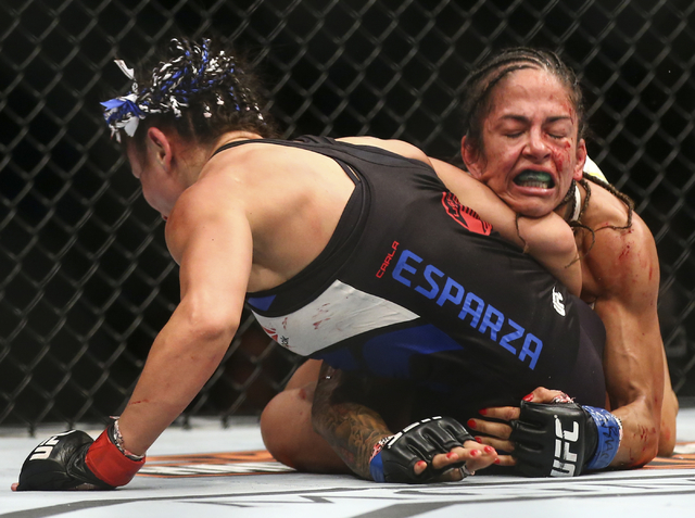 Carla Esparza, left, and Juliana Lima fight during a womenճ strawweight bout in UFC 197 at the MGM Grand Garden Arena in Las Vegas on Saturday, April 23, 2016. Chase Stevens/Las Vegas Review ...