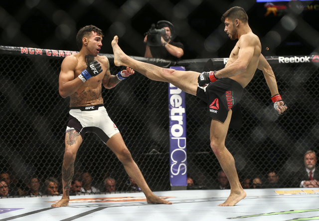 Yair Rodriguez throws a kick at Andre Fili during a featherweight bout in UFC 197 at the MGM Grand Garden Arena in Las Vegas on Saturday, April 23, 2016. Chase Stevens/Las Vegas Review-Journal Fol ...