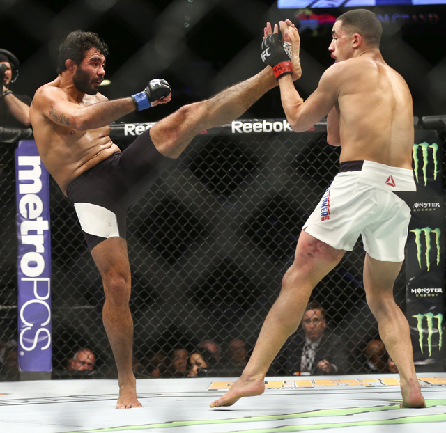 Rafael Natal, left, throws a kick at Robert Whittaker during a middleweight bout in UFC 197 at the MGM Grand Garden Arena in Las Vegas on Saturday, April 23, 2016. Whittaker won by unanimous decis ...
