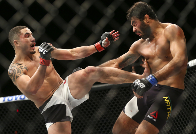 Robert Whittaker, left, lands a kick against Rafael Natal during a middleweight bout in UFC 197 at the MGM Grand Garden Arena in Las Vegas on Saturday, April 23, 2016. Whittaker won by unanimous d ...