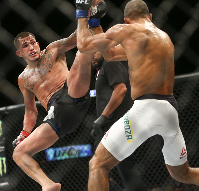 Anthony Pettis goes up for a kick against Edson Barboza during a lightweight bout in UFC 197 at the MGM Grand Garden Arena in Las Vegas on Saturday, April 23, 2016. Barboza won by unanimous decisi ...