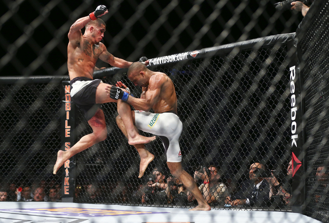 Anthony Pettis attempts a flying knee against Edson Barboza during a lightweight bout in UFC 197 at the MGM Grand Garden Arena in Las Vegas on Saturday, April 23, 2016. Barboza won by unanimous de ...