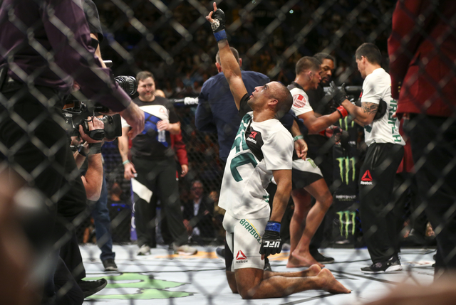 Edson Barboza celebrates his win over Anthony Pettis in a lightweight bout at UFC 197 at the MGM Grand Garden Arena in Las Vegas on Saturday, April 23, 2016. Barboza won by unanimous decision. Cha ...