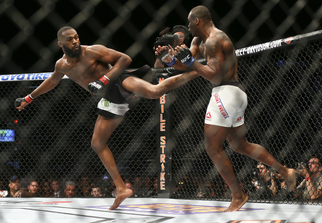 Jon Jones lands a kick against Ovince Saint Preux during an interim light heavyweight championship bout in UFC 197 at the MGM Grand Garden Arena in Las Vegas on Saturday, April 23, 2016. Jones won ...