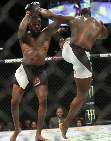 Jon Jones, left, fights Ovince Saint Preux during an interim light heavyweight championship bout in UFC 197 at the MGM Grand Garden Arena in Las Vegas on Saturday, April 23, 2016. Jones won by una ...