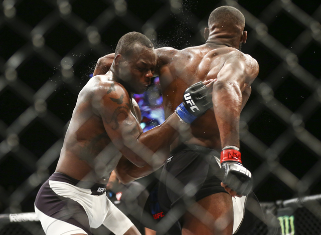 Jon Jones elbows Ovince Saint Preux during an interim light heavyweight championship bout in UFC 197 at the MGM Grand Garden Arena in Las Vegas on Saturday, April 23, 2016. Jones won by unanimous  ...