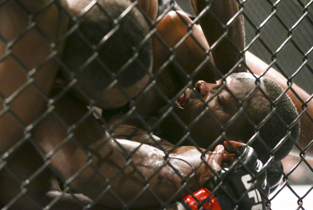 Jon Jones, left, keeps Ovince Saint Preux on the mat during an interim light heavyweight championship bout in UFC 197 at the MGM Grand Garden Arena in Las Vegas on Saturday, April 23, 2016. Jones  ...
