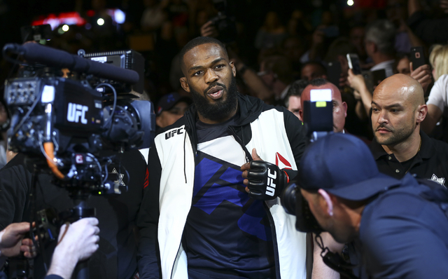 Jon Jones walks towards the octagon to fight Ovince Saint Preux in an interim light heavyweight championship bout at UFC 197 at the MGM Grand Garden Arena in Las Vegas on Saturday, April 23, 2016. ...