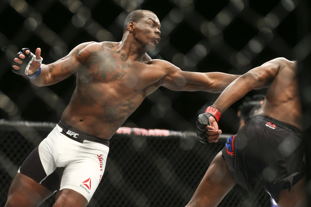 Ovince Saint Preux, left, lands a hit against Jon Jones during an interim light heavyweight championship bout in UFC 197 at the MGM Grand Garden Arena in Las Vegas on Saturday, April 23, 2016. Jon ...
